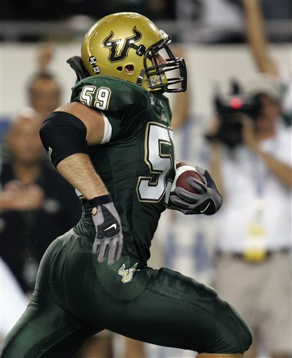Ben Moffitt, taking it to the house, puts South Florida up 7-0.  (AP Photo/Chris O'Meara)