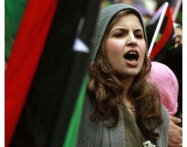 A demonstrator protests against Libya's leader Muammar Gaddafi outside the Libyan Embassy in London